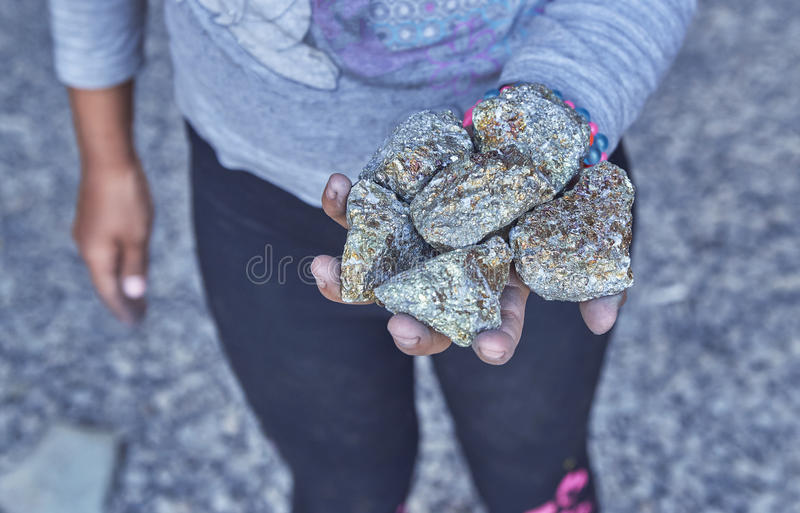 Poor armenian children sell chalcopyrite. To forengers stock images