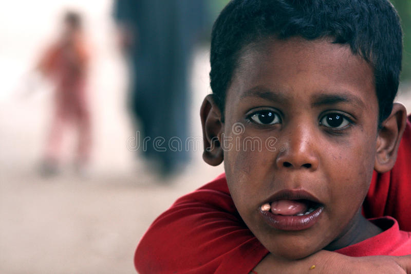 Poor child in egypt stock photography