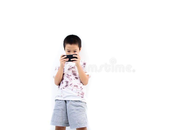 Poor boy and smartphone. stock images