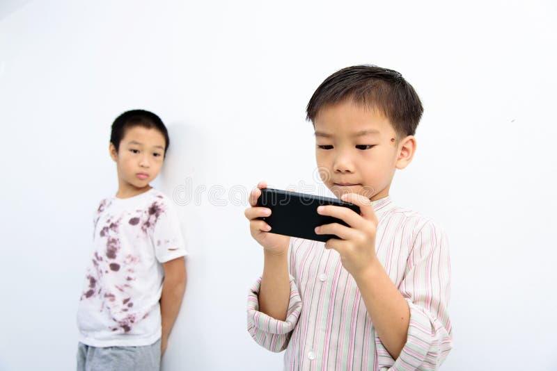 Poor boy and smartphone. stock photo