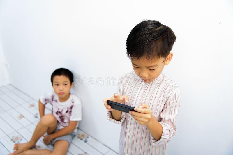 Poor boy and smartphone. stock photos