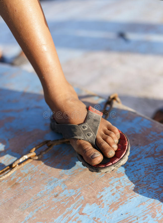 Poor boy wearing flip-flops. Poor boy wearing flip-flops royalty free stock image