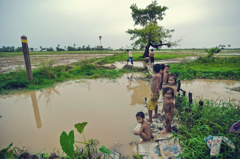 Poor cambodian kids. Fishing scene on Tonle Sap royalty free stock photos