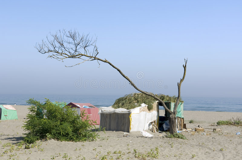 Poor camp on the beach royalty free stock images