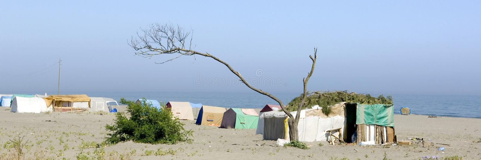 Poor camp on the beach. In Turkey royalty free stock photo