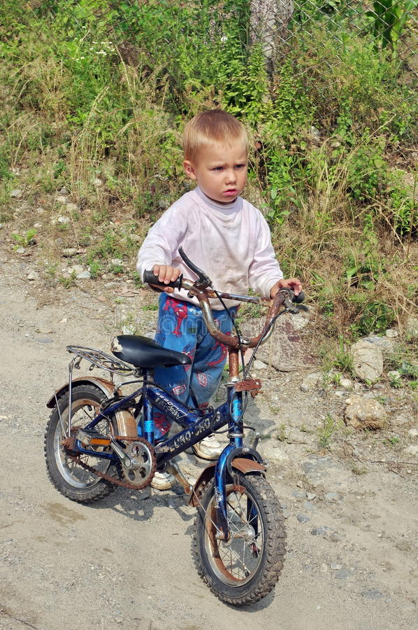 Poor Child With A Bicycle Editorial Photography Image Of Blue