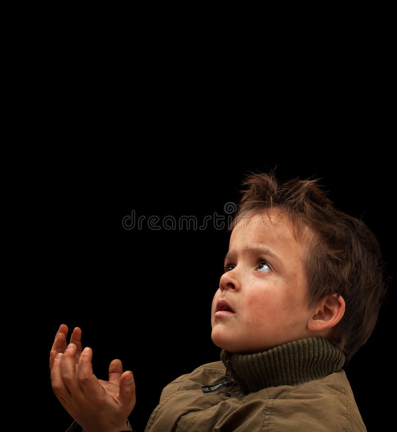 Poor child waiting for a donation stock photo