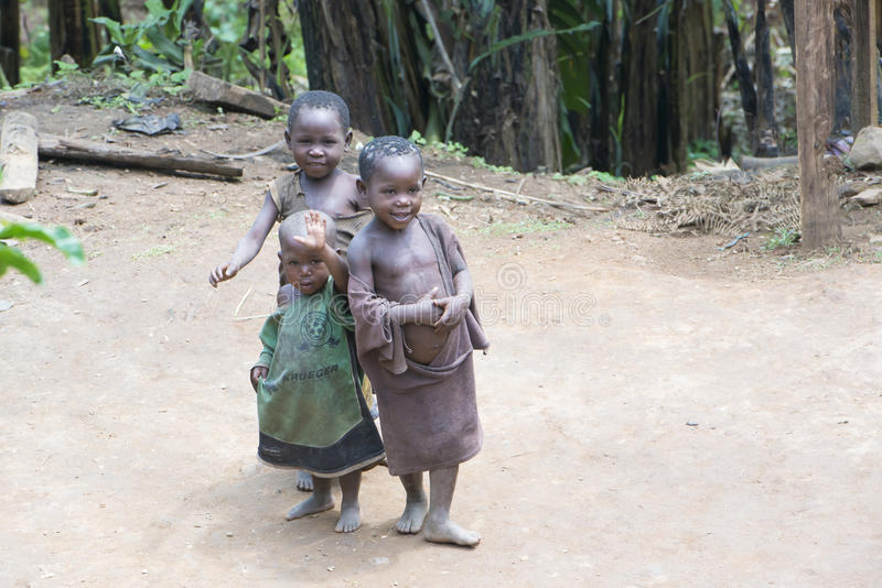 Ugandan Girl Carries Jerry Can On A Dirt Path Editorial