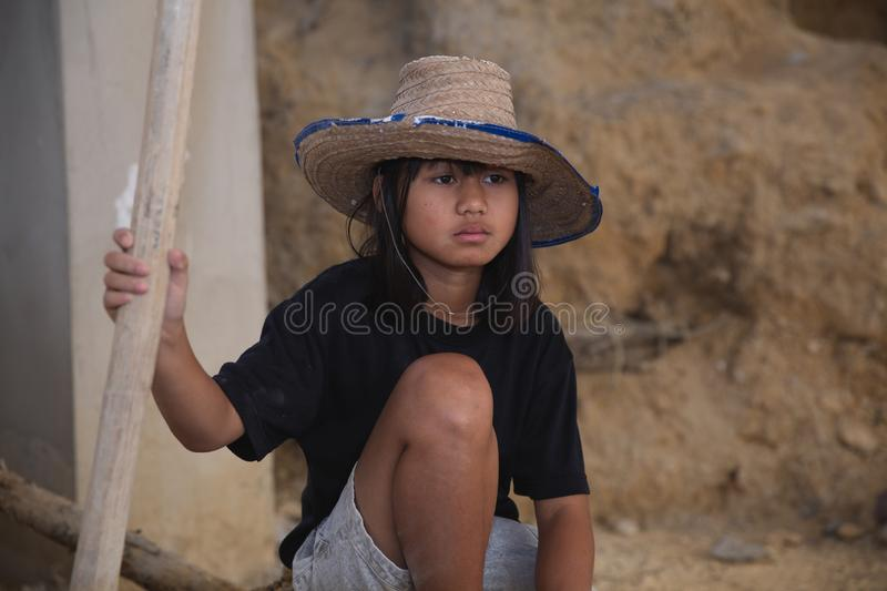 Poor children are forced to work, The child sat on the floor due to tired from hard work, child labor , World Day Against Child stock image