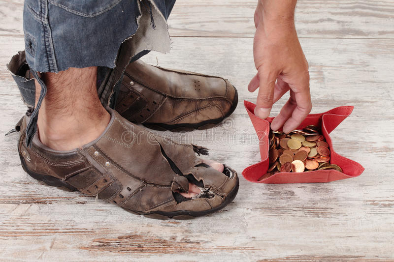 Poor and coins. A poor hands taking some coins royalty free stock photos