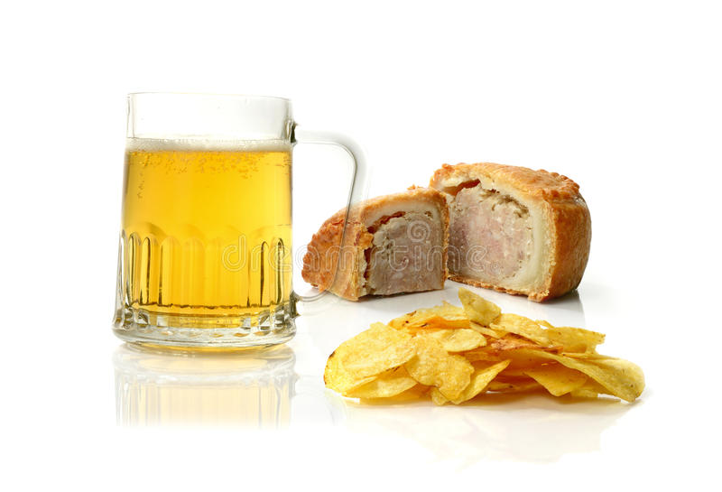 Poor Diet (English). Concept image of a poor English diet enjoyed by many! Beer, potato chips and pork pie. Health care issues surrounding obesity, heart disease stock images