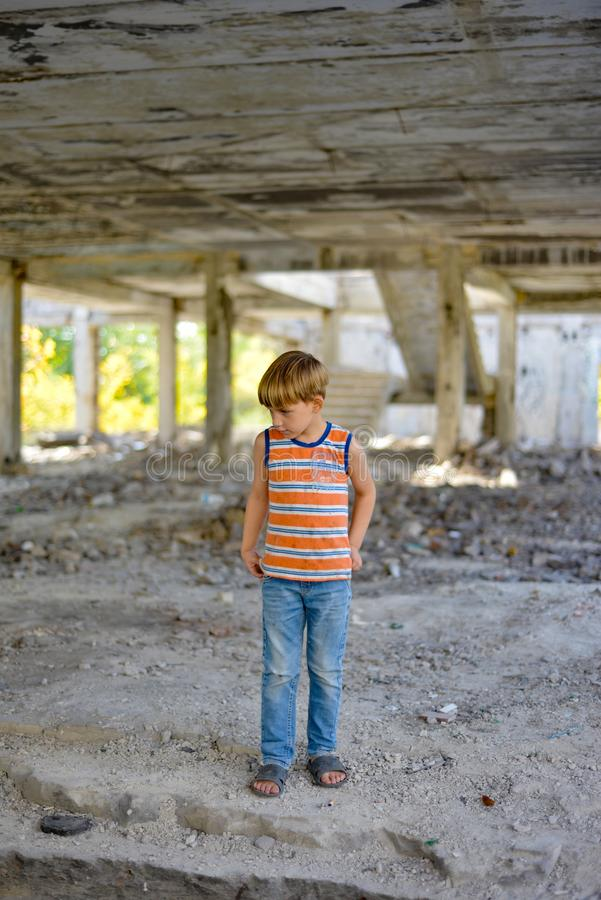 Poor and dirty street children living on an abandoned construction site royalty free stock photo