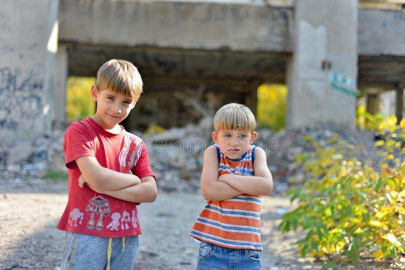 Poor and dirty street children living on an abandoned construction site royalty free stock photos
