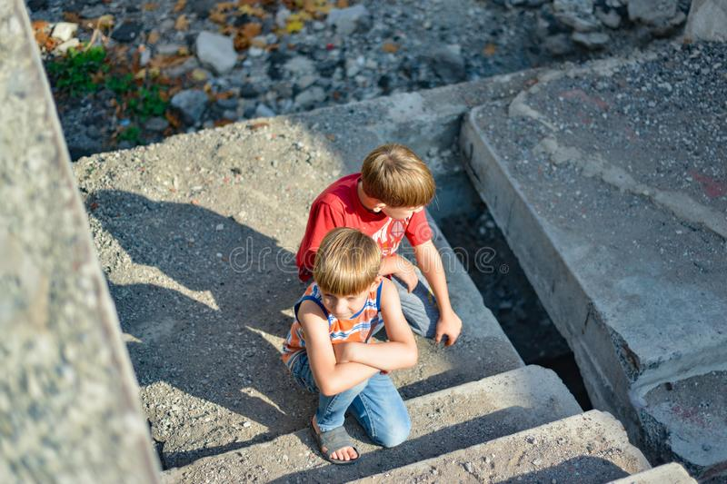 Poor and dirty street children living on an abandoned construction site stock photography
