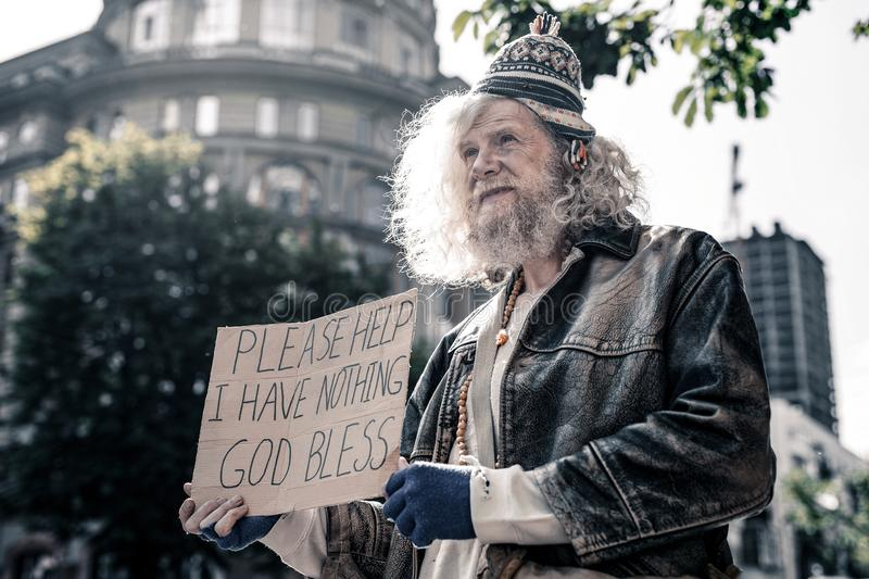 Poor distressed old man having nothing and living on the street royalty free stock photo