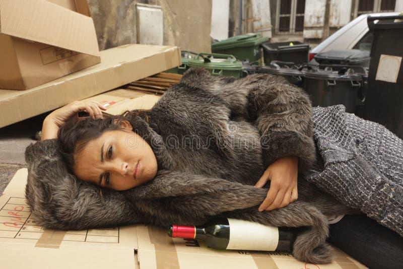 Poor drunk woman stock photo