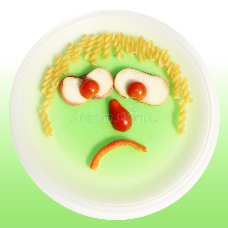 Poor eater, Food face. Made of noodles, tomato and red pepper stock photography