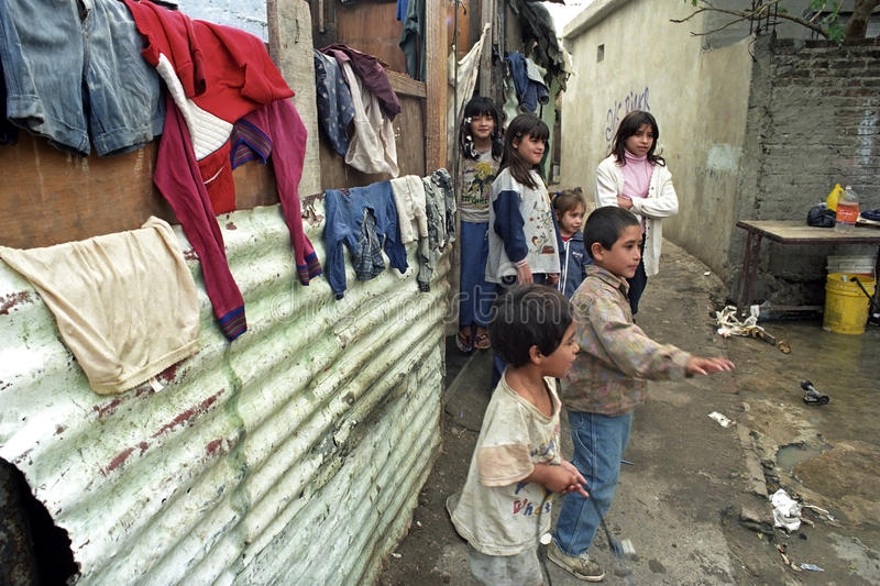 Poor existence of Argentine children in a slum. ARGENTINA, city, capital of Buenos Aires: poor children in their neighborhood in the slum Villa Jardin. The royalty free stock images
