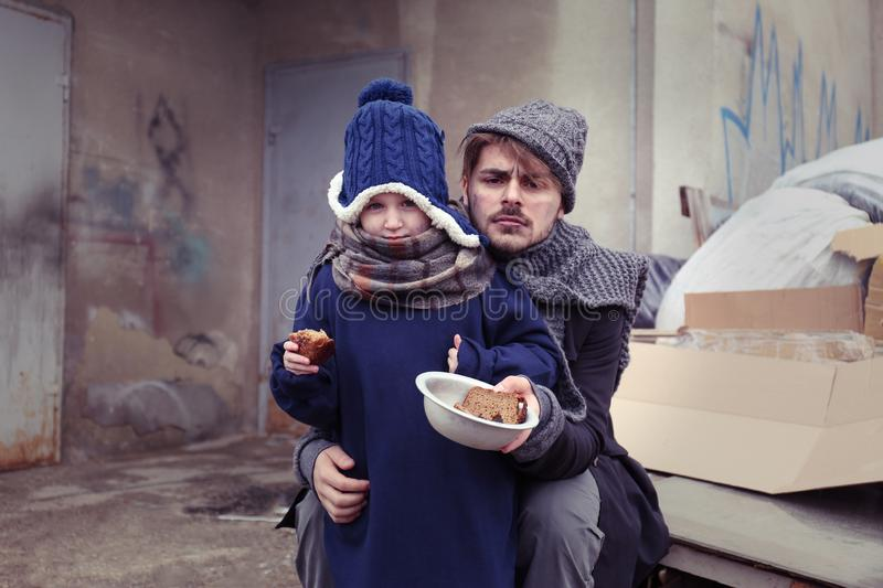 Poor father and child with bread stock photography
