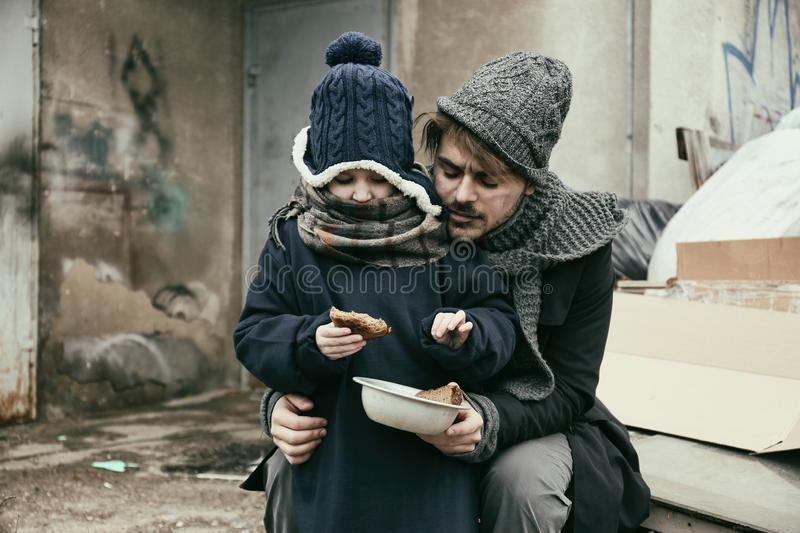 Poor father and child with bread royalty free stock photo