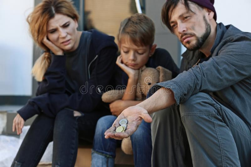 Poor homeless family begging royalty free stock photos