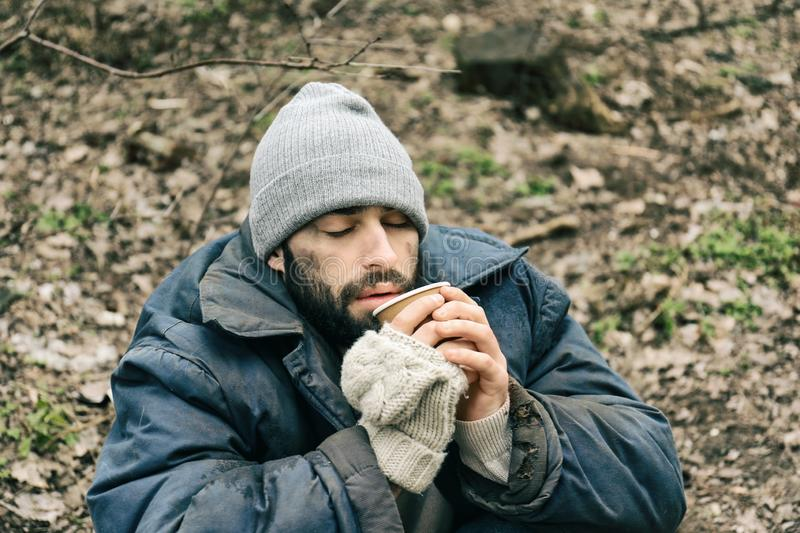 Poor homeless man with cup stock photos