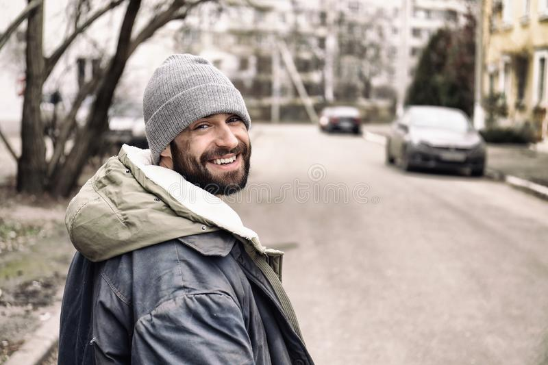 Poor homeless man standing on street royalty free stock images