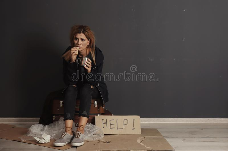 Poor homeless woman with bread stock photo