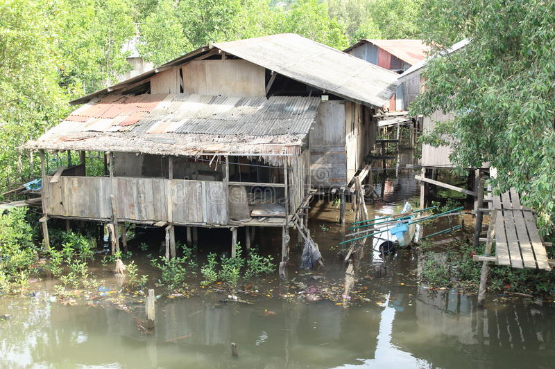 Poor house above river. Poor fishers house above river in Sorong (Papua Barat, Indonesia royalty free stock photos