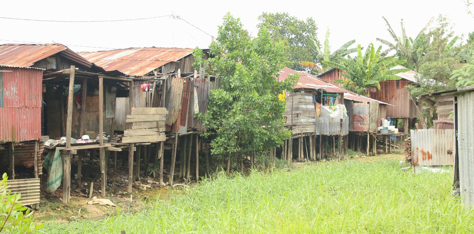 Poor houses above dried river. In Sorong (Papua Barat, Indonesia stock photo