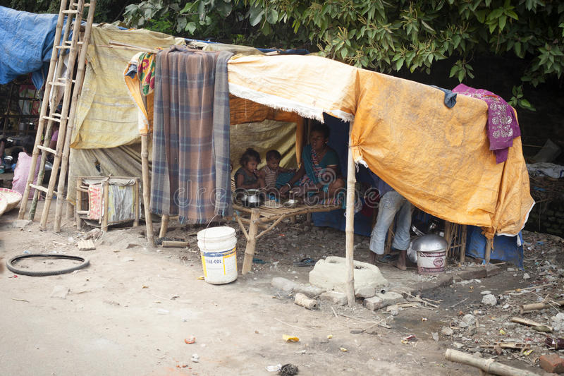 Poor Indian family living in a makeshift shack stock photos