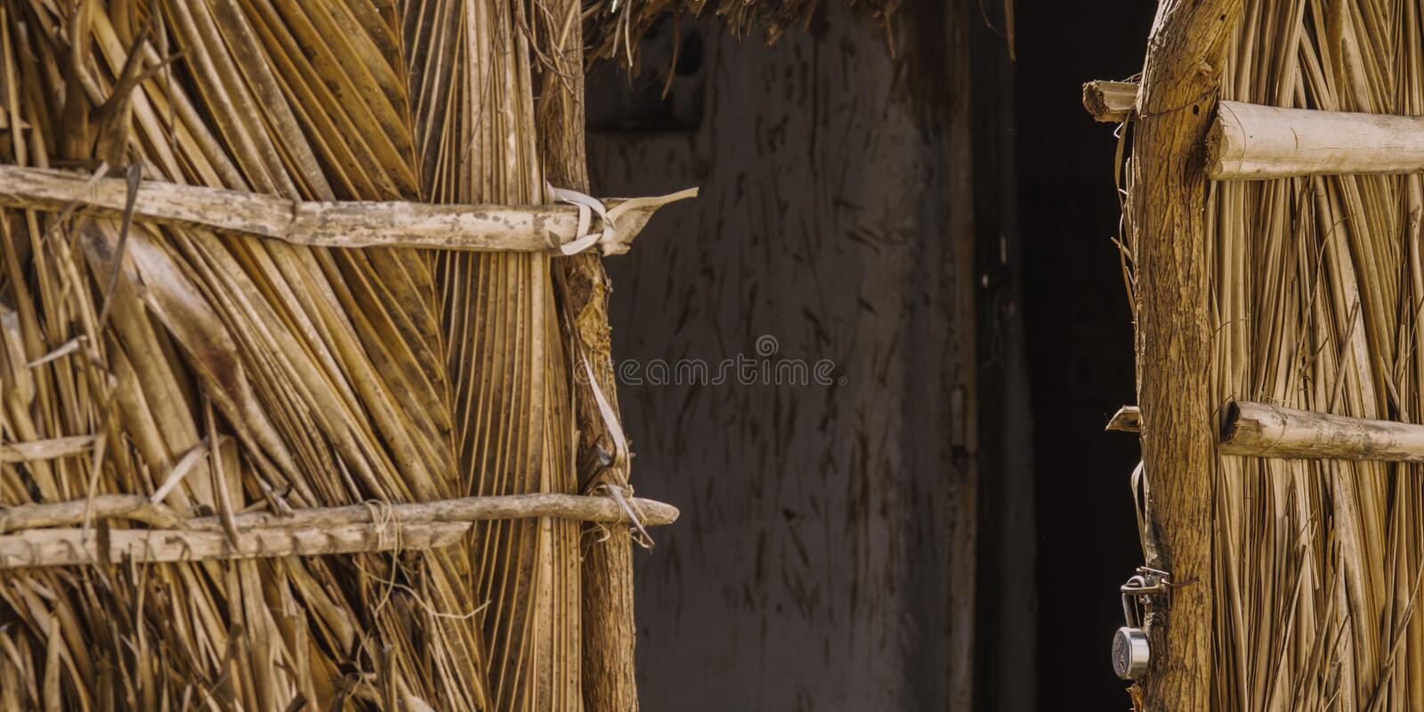 Poor indian village houses, closeup hut door royalty free stock photos