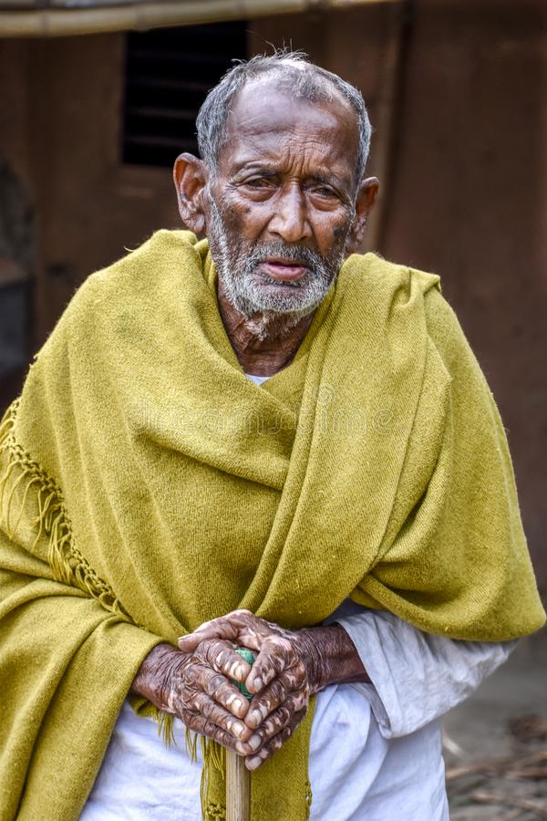 A poor indigenous old man of India looks at the camera with astonished eyes royalty free stock images