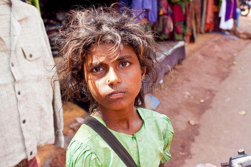 Poor little girl near road stock photo