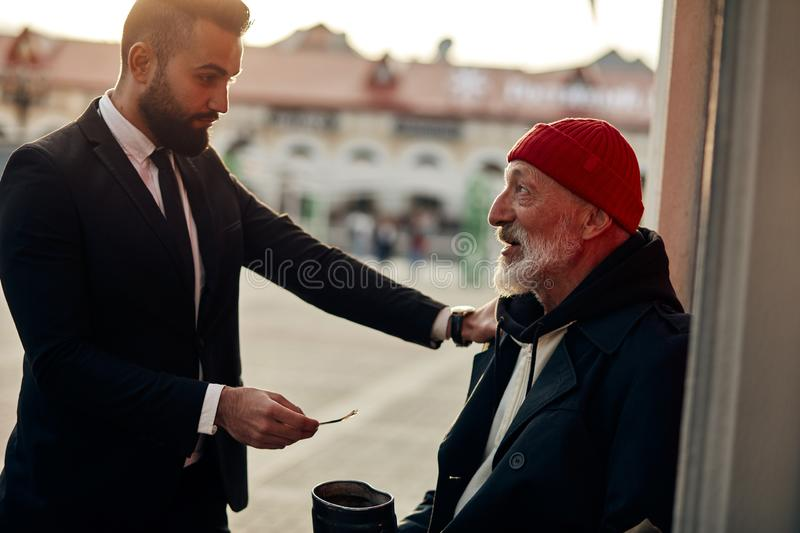 Kind Businessman Help Homeless Giving Money In Street ...