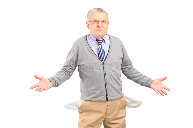 Poor man showing his empty pockets stock photos