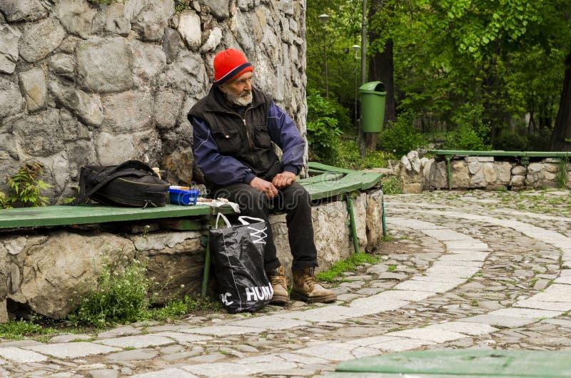 Download Poor Man Sitting On Bench Editorial Image - Image: 40109280