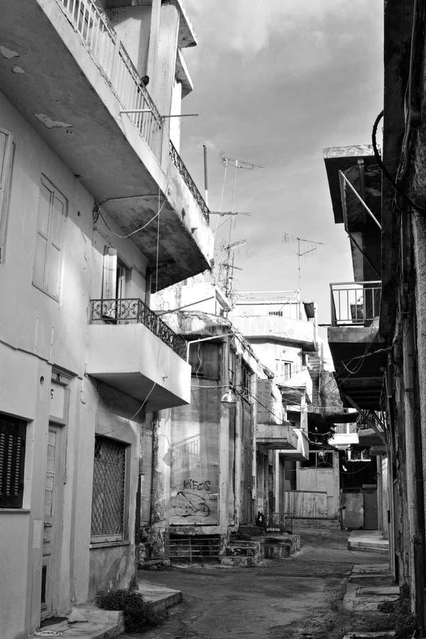Poor neighborhood. Black & white photo of old buildings in a poor neighborhood royalty free stock photo