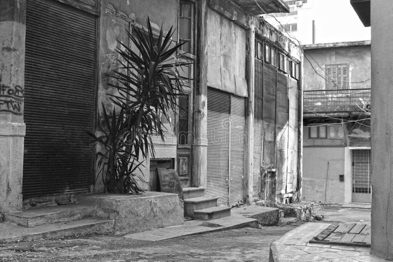 Poor neighborhood. Black & white photo of old buildings in a poor neighborhood stock photos