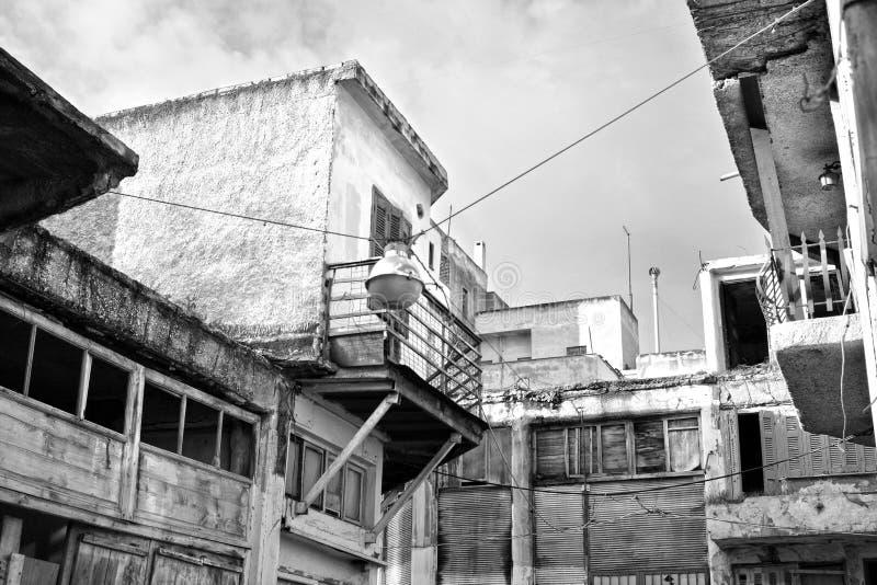 Poor neighborhood. Black & white photo of old buildings in a poor neighborhood stock photography