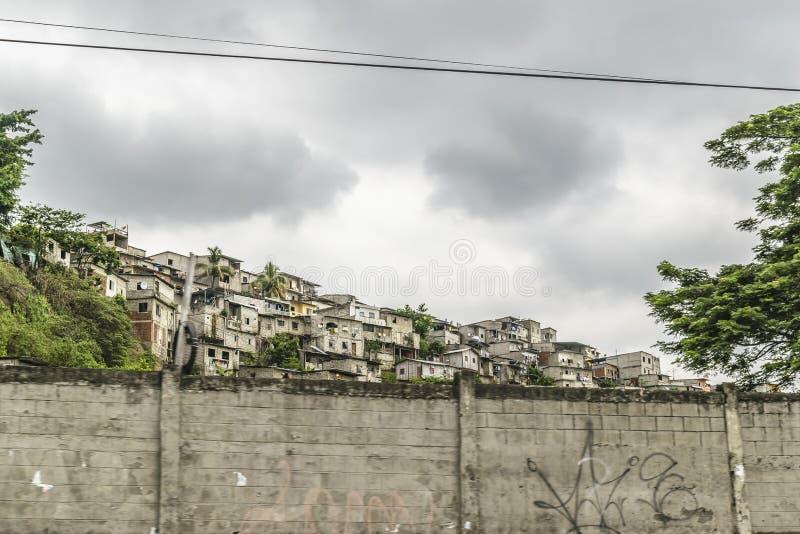 Poor Neighborhood, Guayaquil, Ecuador. Populated poor neighborhood at top of hill in Guayaquil city, Ecuador royalty free stock photo