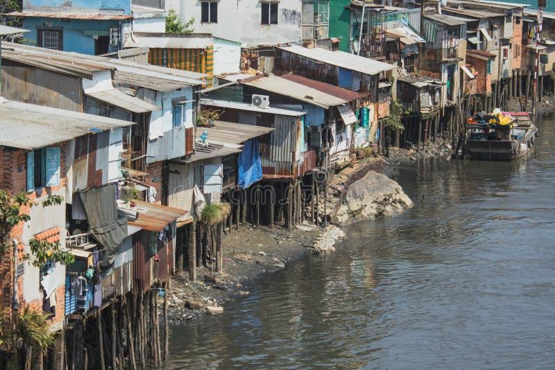 Poor neighborhood  huts on stilts at riverside   in Ho Chi Minh. Poor neighborhood huts on stilts at riverside in Ho Chi Minh City a.k.a. Saigon , Vietnam stock image