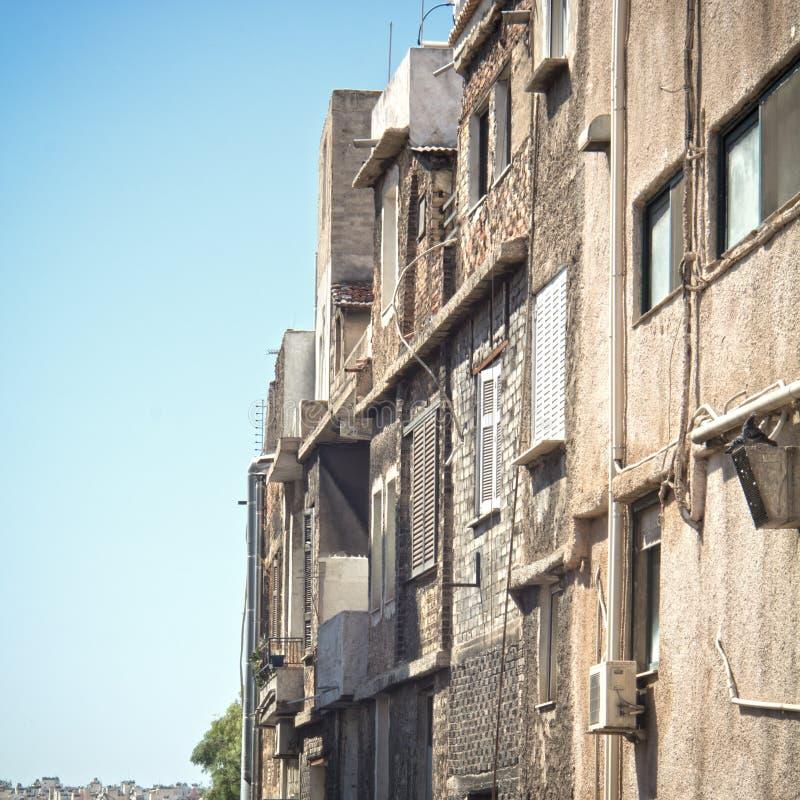 Poor neighborhood. Photo of old buildings in a poor neighborhood stock images