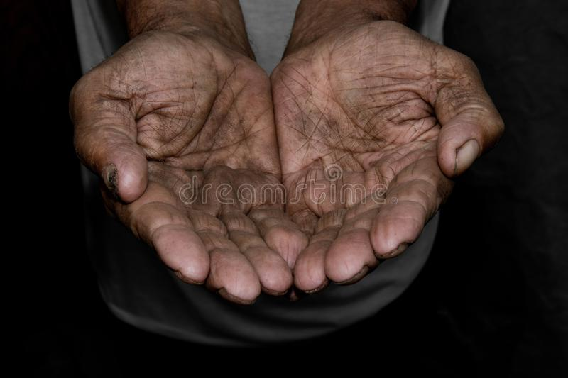 The poor old man& x27;s hands beg you for help. The concept of hunger stock image