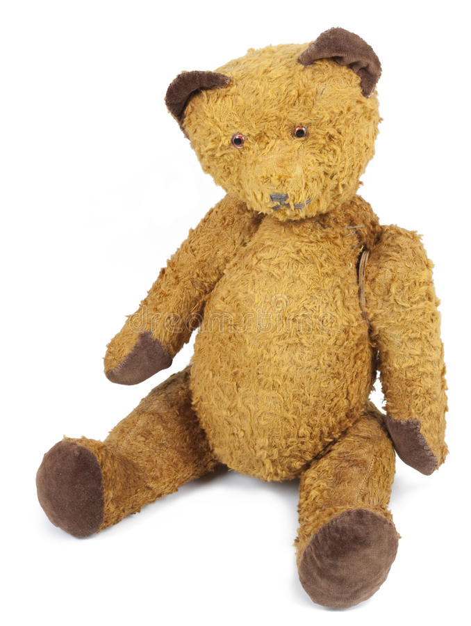 Poor old Taddy bear. Antique Teddy bear looks sad and abandoned. Photo isolated on white background stock photography