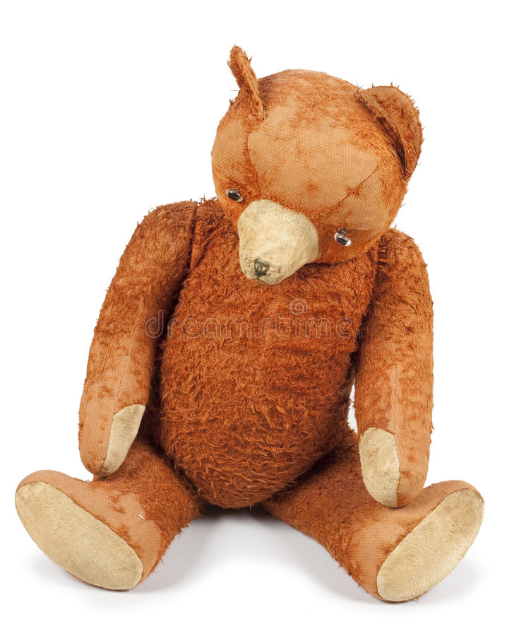 Poor old Taddy bear. Antique Teddy bear looks sad and abandoned. Photo isolated on white background stock image