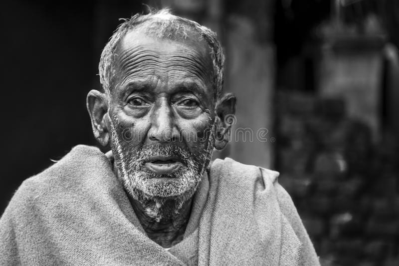 A poor and old tribal beggar of India looked in with frustration stock images