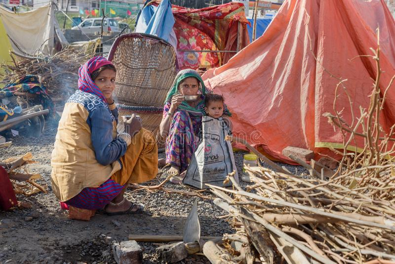 Poor people come with family to the city from the village for work. And they living in the street in tent home. Ajmer. Rajasthan. Ajmer, India - February 07 stock photos