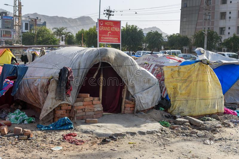 Poor people come with family to the city from the village for work. And they living in the street in tent home. Ajmer. Rajasthan. Ajmer, India - February 07 stock photography