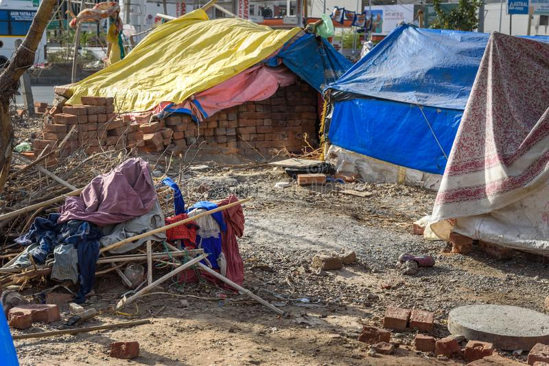 Poor people come with family to the city from the village for work. And they living in the street in tent home. Ajmer. Rajasthan. Ajmer, India - February 07 stock photo